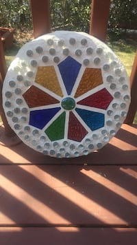 "Stained glass stepping stone about 12"" diameter. West Milford, 07421"