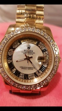 diamond encrusted round gold-colored Rolex analog watch with link bracelet Toronto