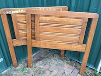 two brown wooden headboards Chesterland