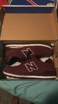 pair of red New Balance sneakers in box Jackson, 39211