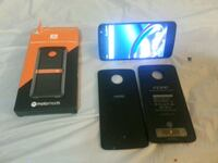 black Samsung Galaxy Android smartphone with two cases Calgary, T2H 1B7