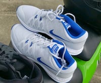 pair of white-and-blue Nike basketball shoes Jacksonville
