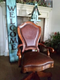 brown wooden framed brown leather padded armchair Caddo