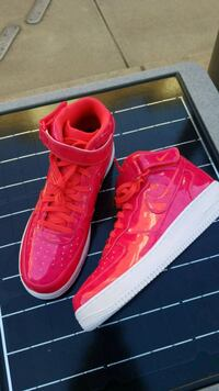 pair of red Nike low top sneakers Charlotte, 28203