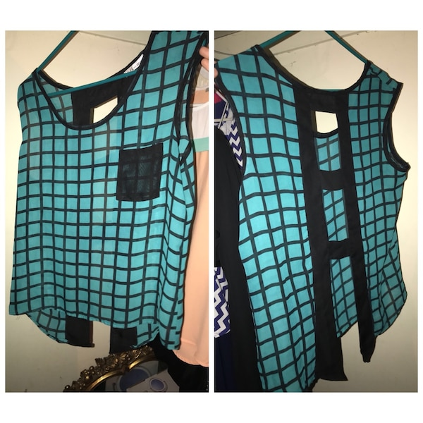 women's teal and black sleeveless top