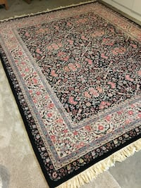 black, brown, and white floral area rug Bend