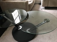 two round glass top table with stand