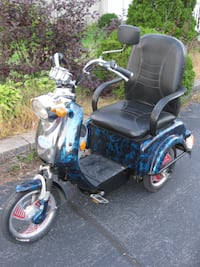 black and blue motorized wheelchair MONTREAL