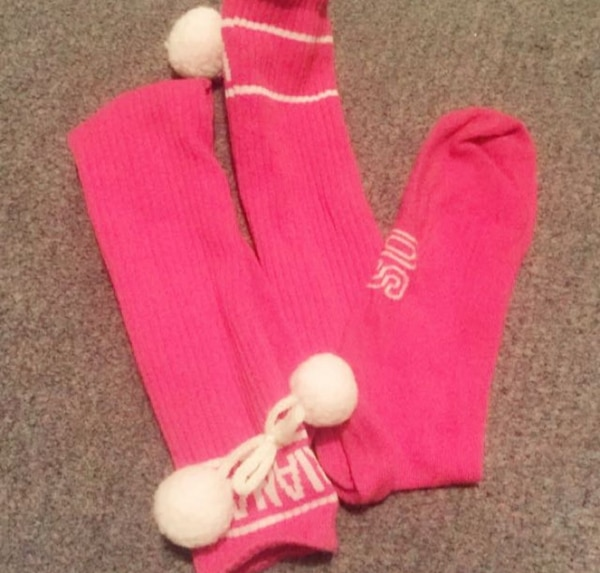 pair of pink-and-white high socks