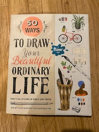 Book and a set of colored pencils, both brand new