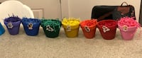 Seven (purple,blue, green, yellow, orange, red, and pink floral containers or Paw Patrol Party decorations. Arlington, 22201