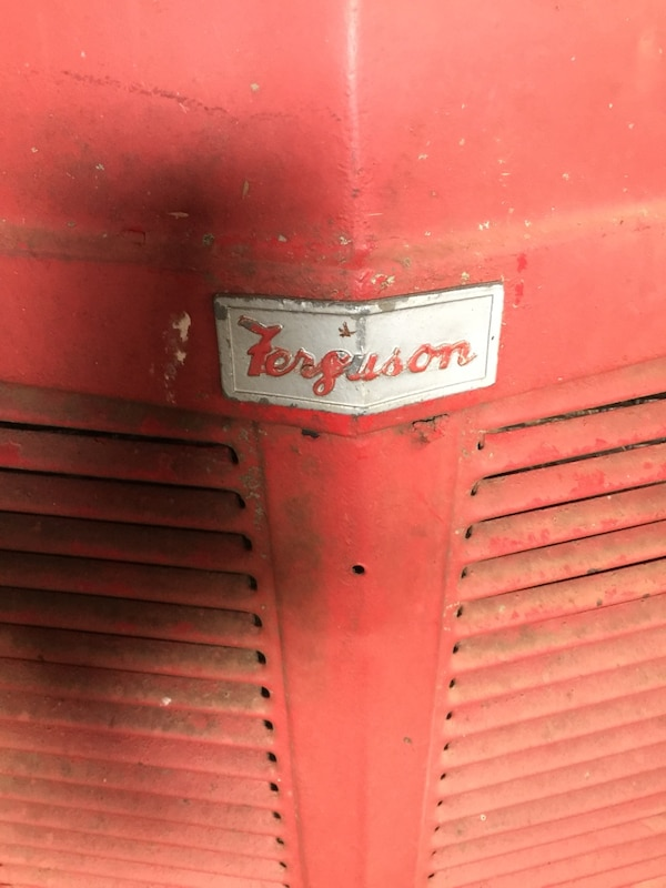 Tractor with implements 1f2c64f4-dc2c-4b92-9b23-e09daa2961bf