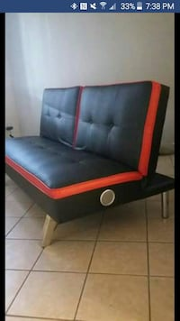 tufted black and red leather armless futon screens