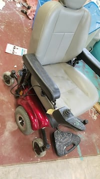 grey and red motorized wheelchair 49 km