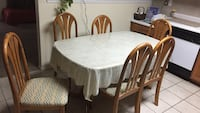 Round brown wooden table with six chairs dining set Arlington, 76017