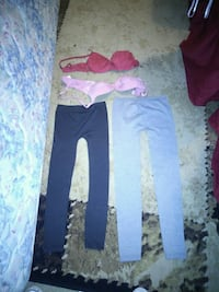 two red and pink brassiers and two sweat pants