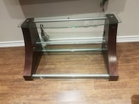 clear glass-top TV stnad with brown wooden base Vaughan, L6A 3R1
