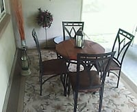 round brown wooden table with four chairs dining set Richmond, 23231