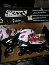 white-and-red Bauer inline skates with box