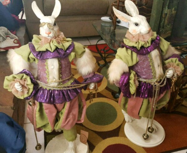 two white and purple dressed female dolls