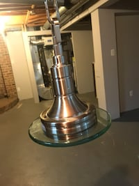 Stainless steel and glass ceiling fixture.