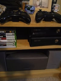 2 xbox 360 slims. 2 controllers 7 games
