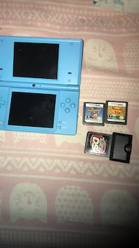 blue Nintendo DS with game cartridges Olive Branch, 38654