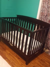 baby's brown wooden crib Overland Park, 66212