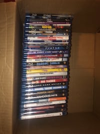 box of 27 blue ray movies and 21 DVDs for 40$