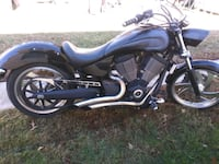 black and gray standard motorcycle 64 km