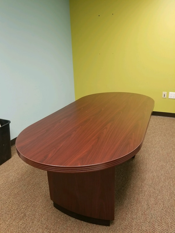 round brown wooden conference table