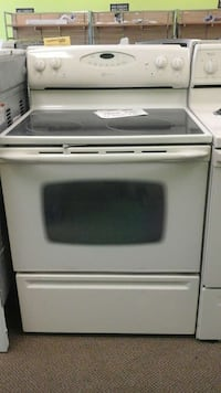 white and black smooth top range oven