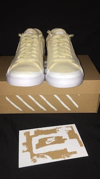 pair of white high top sneakers on box Peoria, 85381
