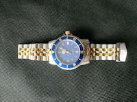 round gold-colored analog watch with link bracelet 777 km