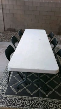 1 8foot folding leg table & 6 metal folding chairs I'm firm on price Las Vegas, 89135