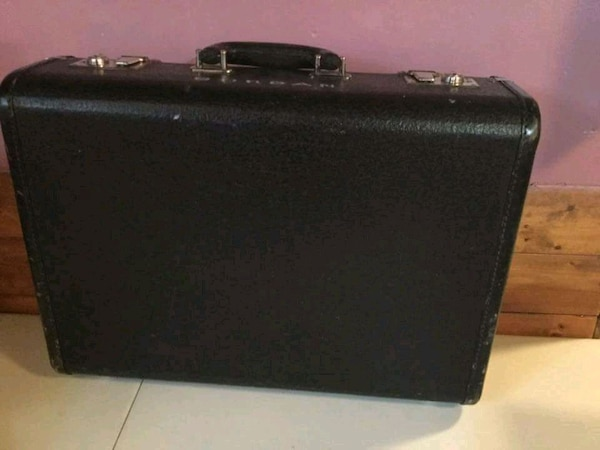 Black leather vintage suitcase with blue satin lin