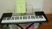 Casio LH175 LIGHT up keyboard, song book & cord