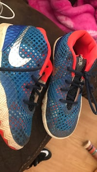 pair of blue-and-red Nike running shoes Inman, 29349