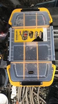 yellow and white Stanley plastic toolbox