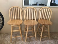 three brown wooden windsor chairs West Palm Beach, 33406