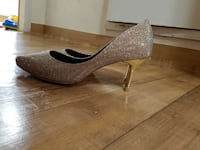 gray and brown heeled shoes