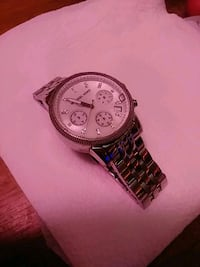 round silver-colored chronograph watch with link b Philadelphia, 19149