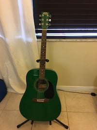 Green acoustic Stagg guitar, tuner and stand included Boca Raton