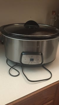 Grey stainless steel black and decker slow cooker used once