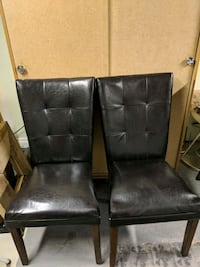 4 black leather chairs and round kitchen table Lethbridge, T1H