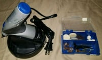 black and blue corded power tool 52 km