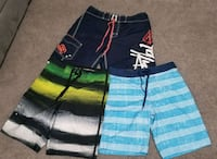 three assorted-color board shorts Houston, 77042