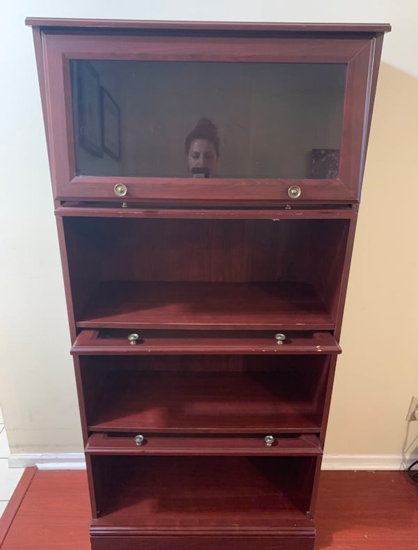 Gorgeous wooden storage cabinet, cute knobs and glass front cf93654e-76f1-46c0-8edc-c0ae4a047d55