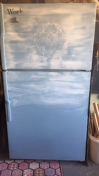 my work shop fridge yes that is a raised carving on the front and yes it is painted blue and shabby chic lol needs cleaned inside tho!  Jacksonville, 28540