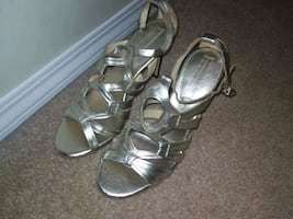 pair of silver open-toe ankle strap heels